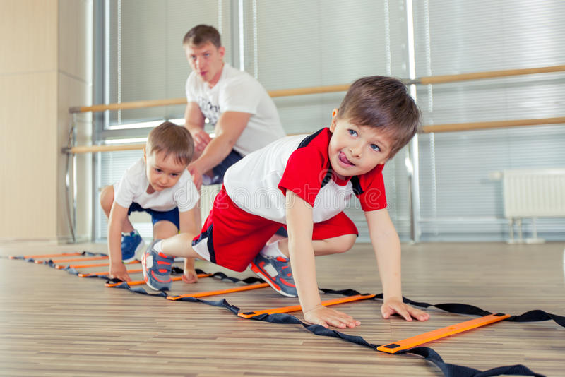 Happy sporty children in gym. royalty free stock image