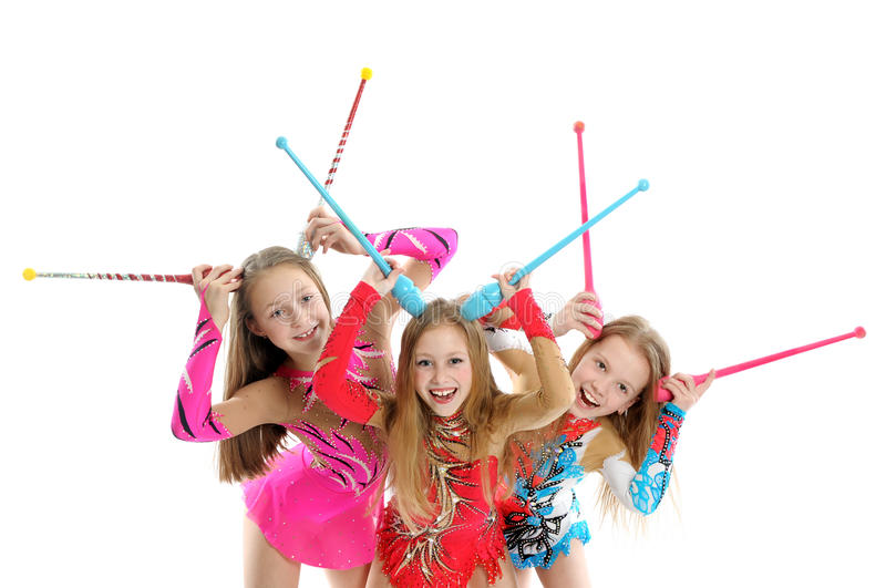 Happy sporty children with gymnastic clubs royalty free stock photography