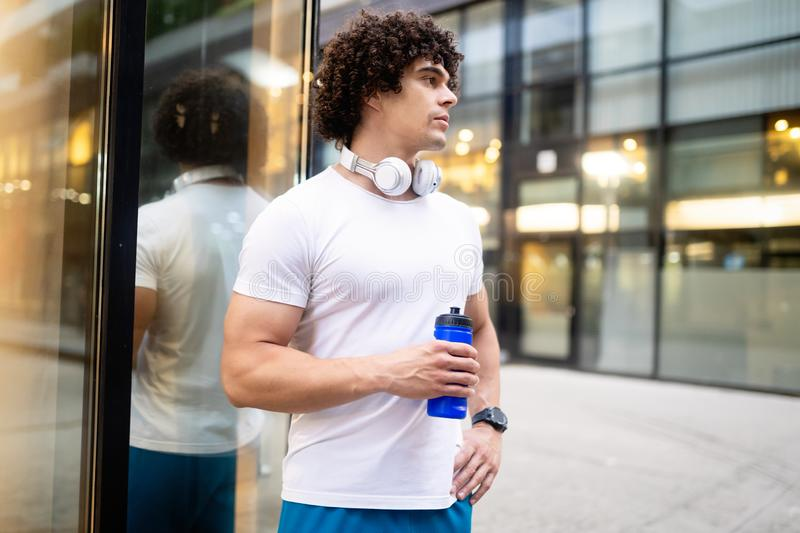 Happy sporty fit man running to stay healthy outdoor stock photography