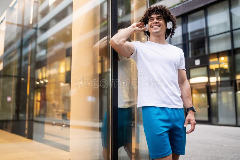 Happy sporty fit man running to stay healthy outdoor stock photo
