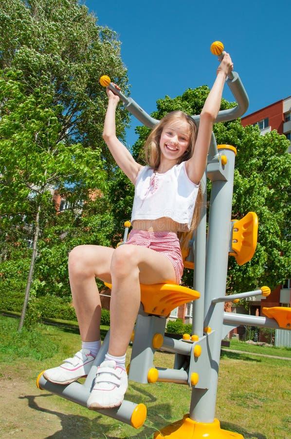 Happy sporty girl outdoors stock photo