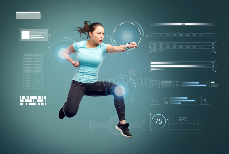 Happy sporty young woman jumping in fighting pose. Sport, fitness, motion and people concept - happy young woman jumping in air in fighting pose over blue royalty free stock images