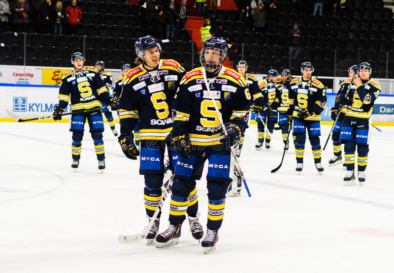 Happy SSK players after they won the Ice hockey match with 3-2 in hockeyallsvenskan between SSK and MODO. Sodertalje, Sweden - January 15, 2017: Happy SSK royalty free stock images