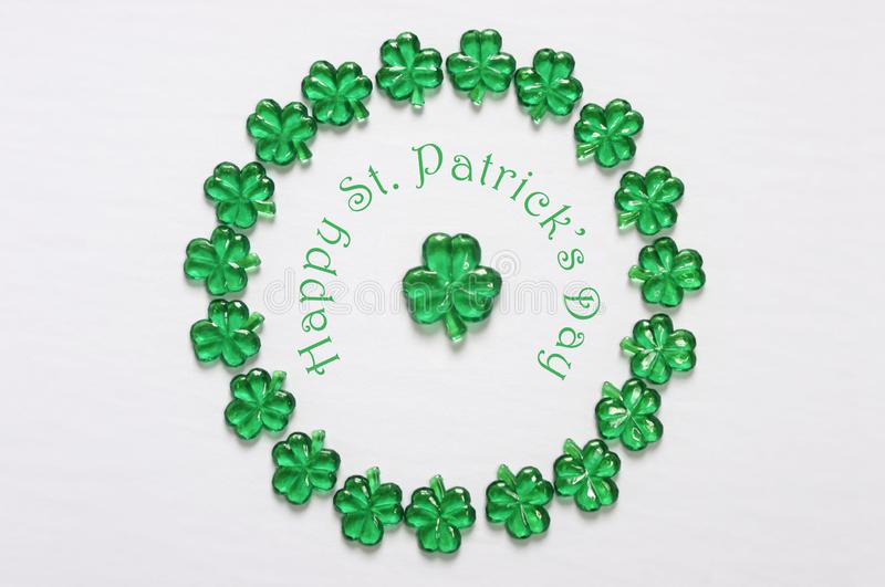 Circle frame of glass shamrocks with Happy St Patrick`s` Day royalty free stock image