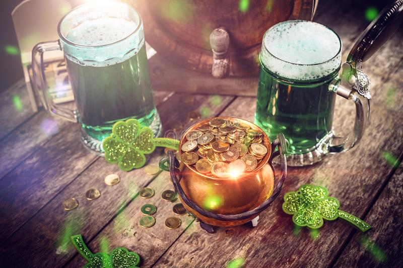Happy St Patrick`s Day. Concept with cauldron of gold coins and green beer
