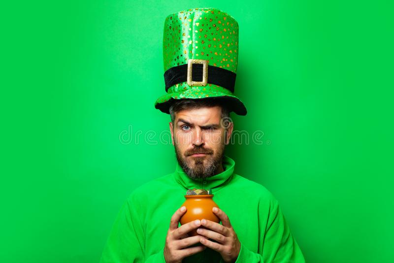 Happy St Patricks Day concept with pot of gold. Pot with money for St. Patrick`s Day. Patricks Day Pot of Gold and stock image