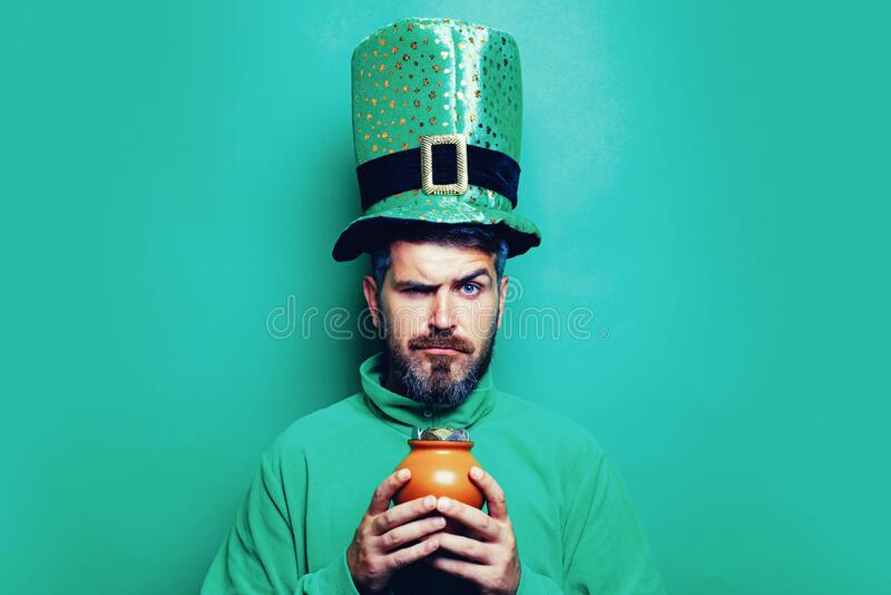 Happy St Patricks Day concept with pot of gold. Pot with money for St. Patrick`s Day. Patricks Day Pot of Gold and royalty free stock image