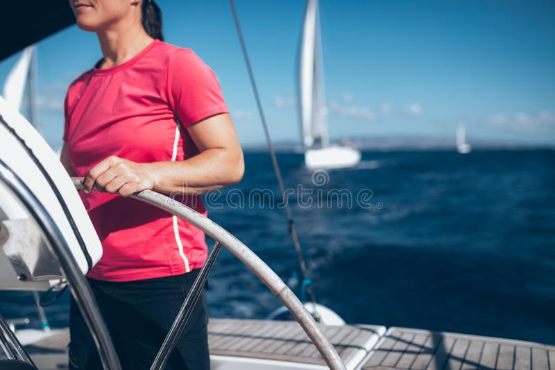 Happy strong woman sailing with her boat. Happy strong sport woman sailing with her boat stock photos