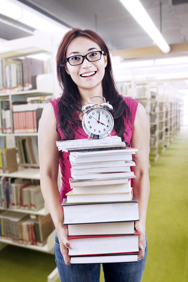 Download Happy Student With Books And Clock Stock Image - Image of learning, hair: 28065729