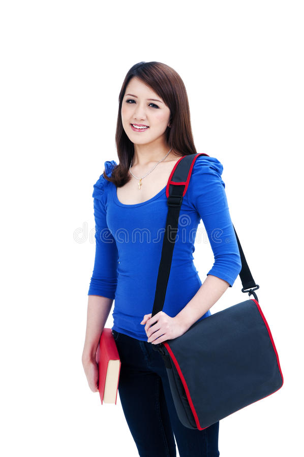 Happy student carrying book and bag royalty free stock photography