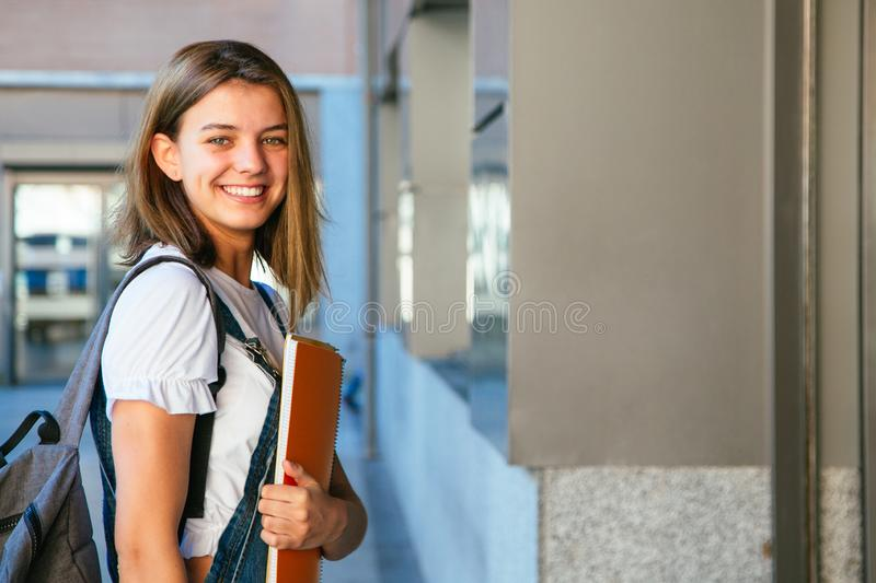 Happy student girl at the college stock photography