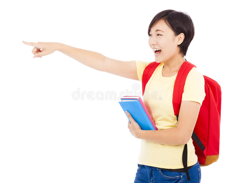 Happy student girl holding book and pointing royalty free stock image