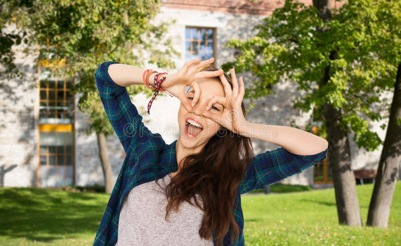 Happy student girl making face and having fun stock image