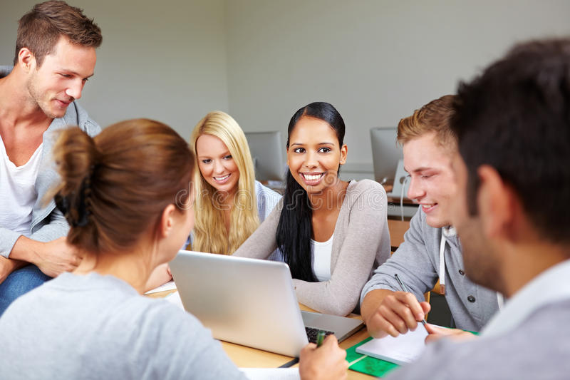 Happy student with peers in college royalty free stock images