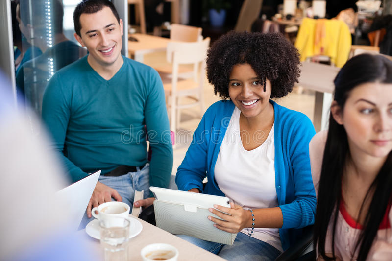 Download Happy students in cafe stock photo. Image of multi, friends - 30947732