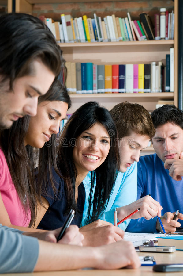 Happy students in college library stock photos