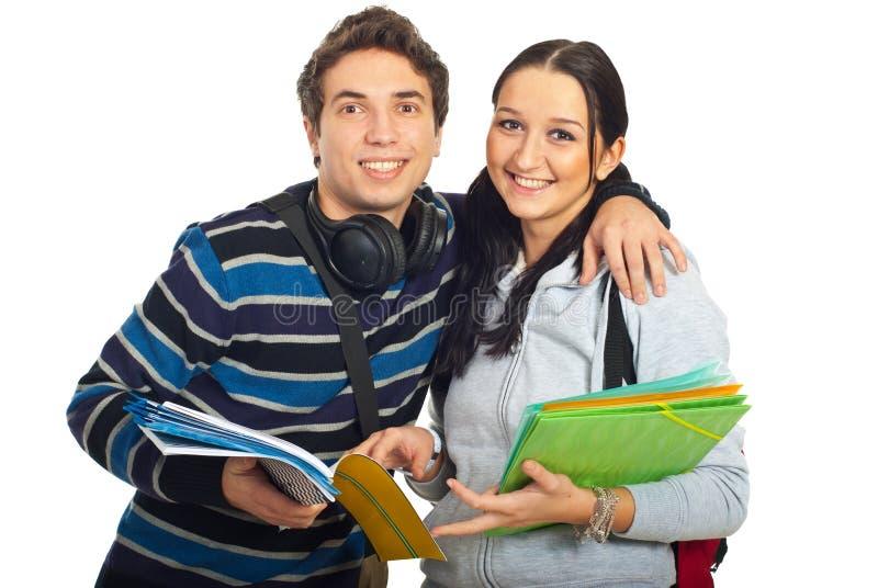 Happy students couple embrace