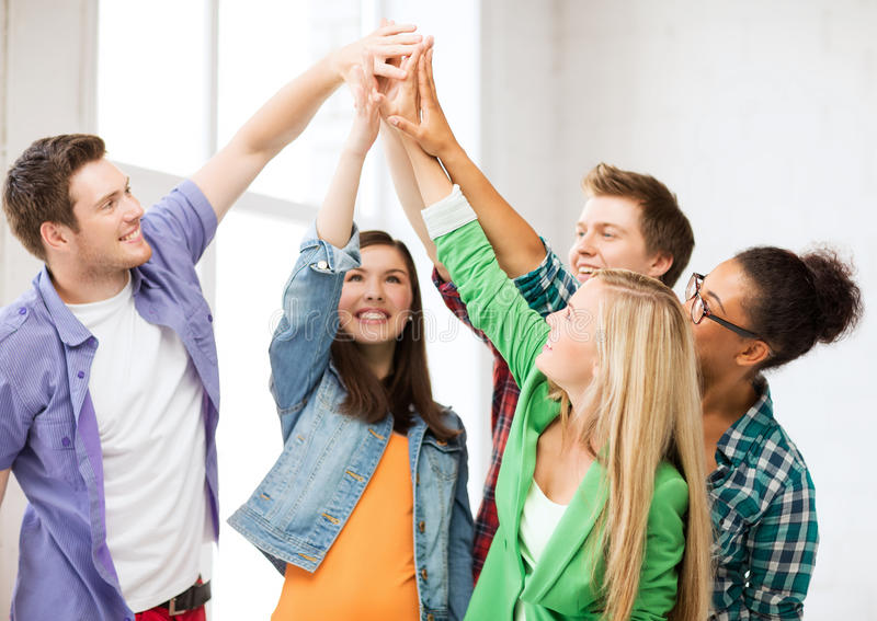 Download Happy Students Giving High Five At School Stock Photo - Image: 33187264