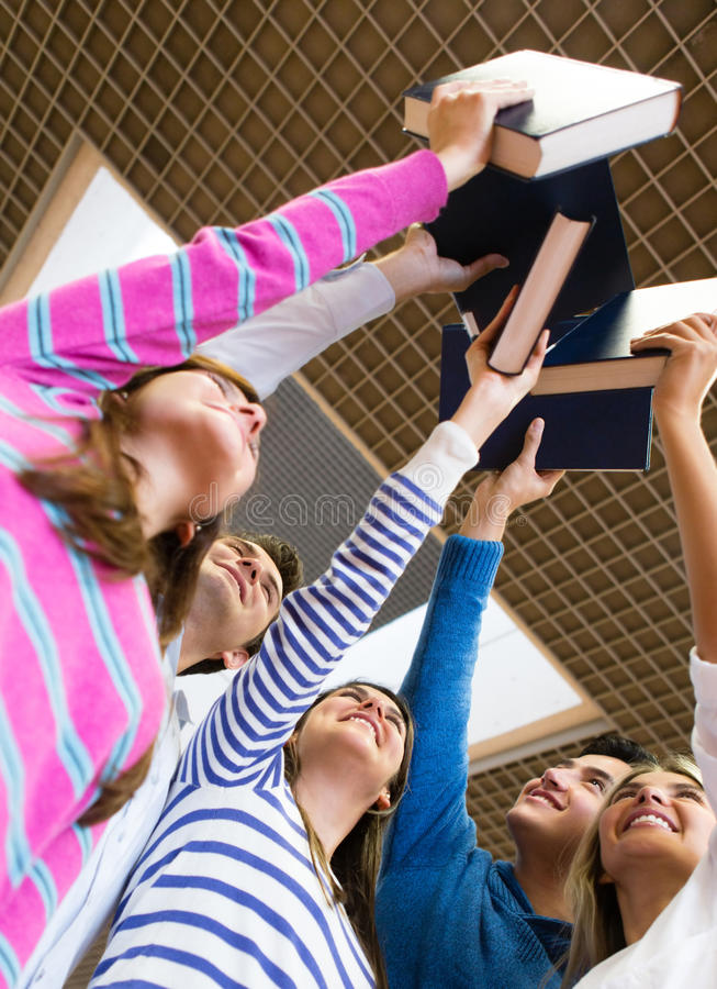 Download Happy Students Holding Books Stock Photo - Image: 25466364