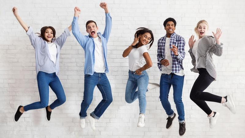 Happy students jumping on white background, passed exams royalty free stock photos
