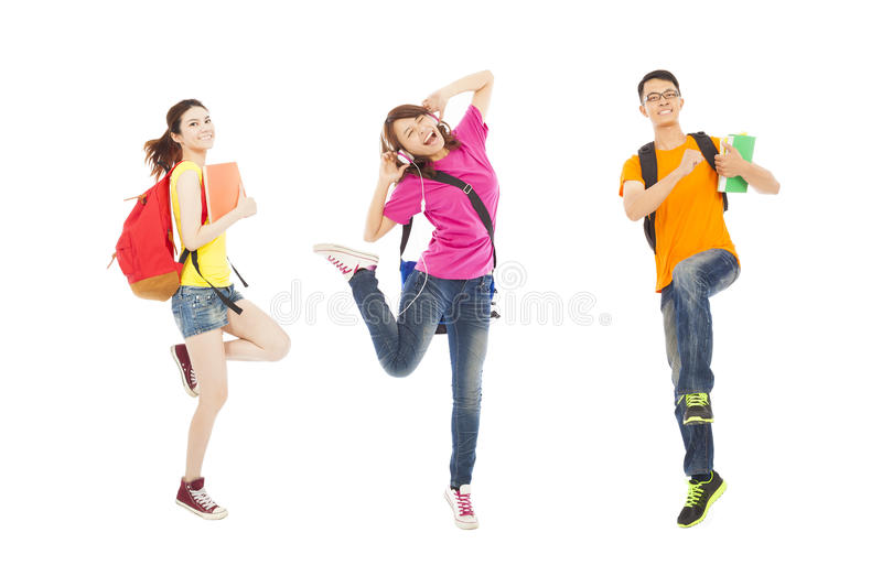 Happy students listening music and jumping with books royalty free stock images