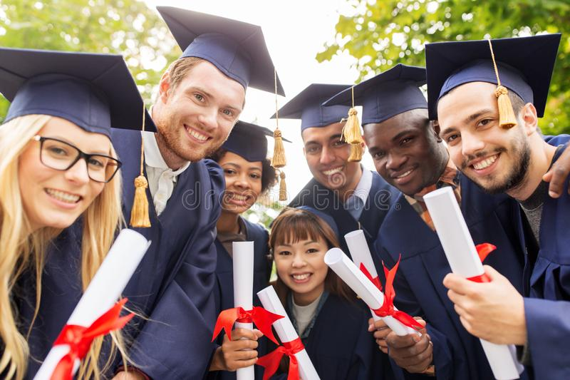 Download Happy Students In Mortar Boards With Diplomas Stock Image - Image of cheerful, black: 105003697