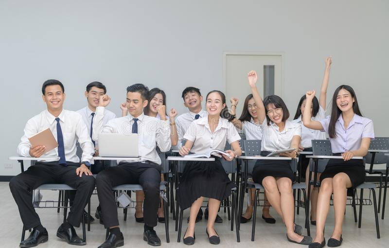 Happy Students in uniform working with laptop royalty free stock image