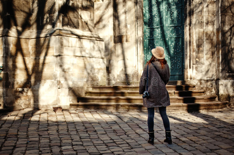 Happy and stylish pretty hipster woman holding film photo camera royalty free stock photography