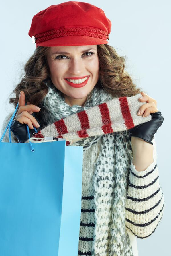 Happy stylish woman with blue shopping bag showing purchases royalty free stock photos