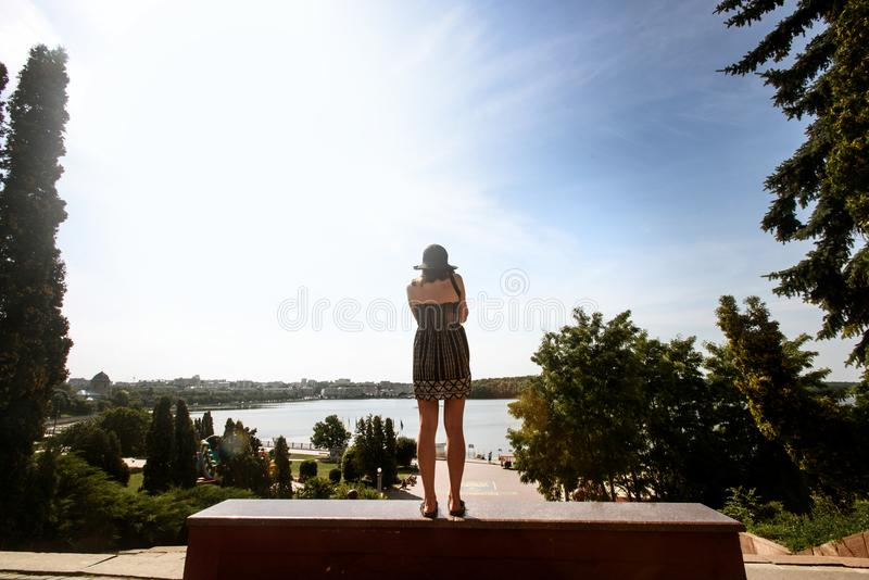 Happy stylish woman looking at cityscape and sky and taking pho. To, summer travel concept royalty free stock images