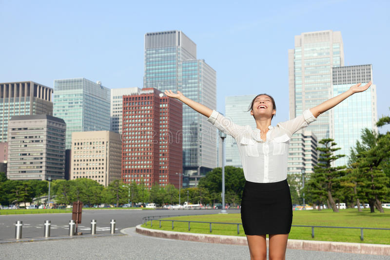 Happy success japanese businesswoman in Tokyo. Happy free businesswoman cheering open arms in achievement and success, Japanese woman carefree in front of Tokyo stock image