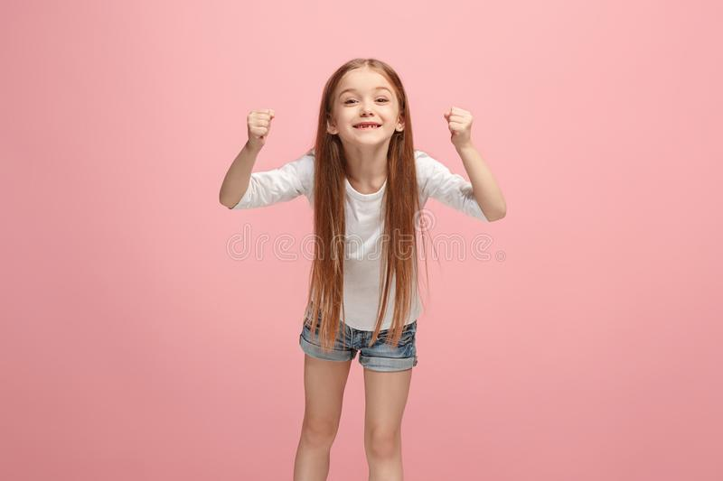 Happy success teen girl celebrating being a winner. Dynamic energetic image of female model royalty free stock image