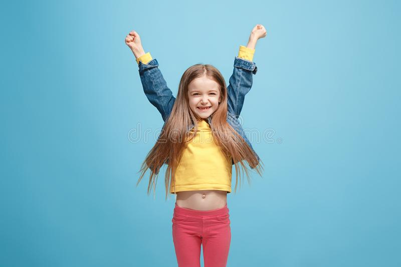 Happy success teen girl celebrating being a winner. Dynamic energetic image of female model stock photo