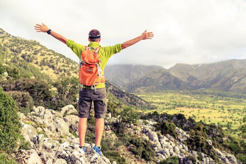 Happy success winner, life goal success hiker man royalty free stock photography