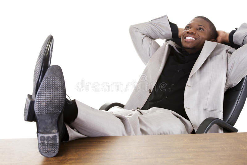 Happy successful businesman at the desk. royalty free stock image