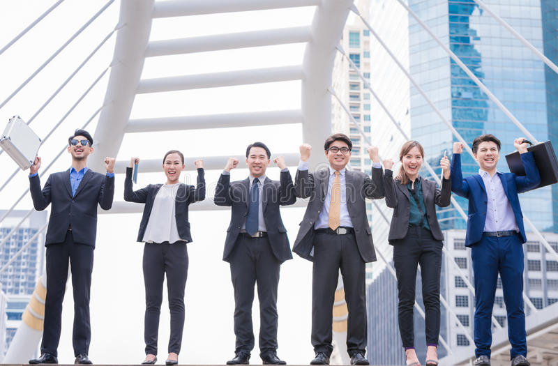 Happy Successful business group People Hands Raised successful with city background Successful business group with arms up royalty free stock photos