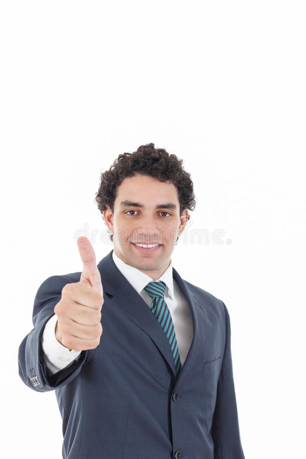Happy successful businessman showing thumbs up gesture stock photography