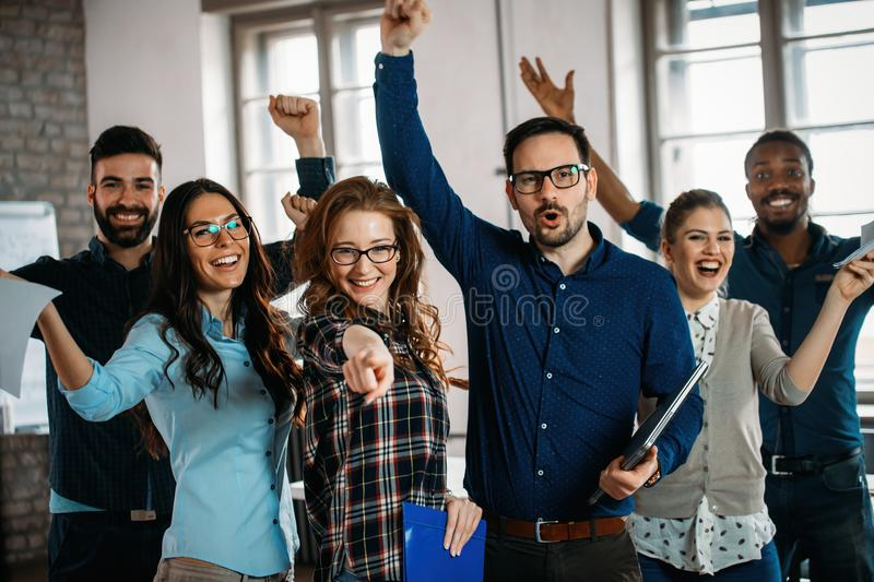 Happy successful company staff in office stock images