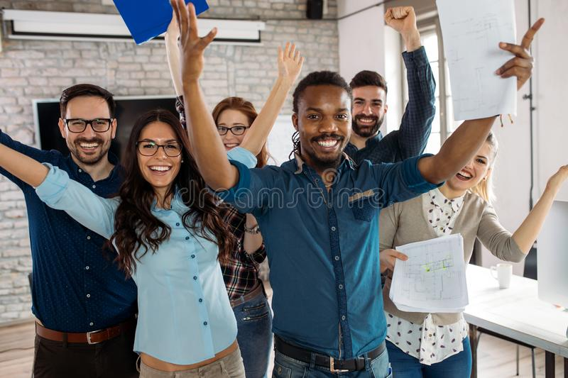 Happy successful company staff in office stock photography