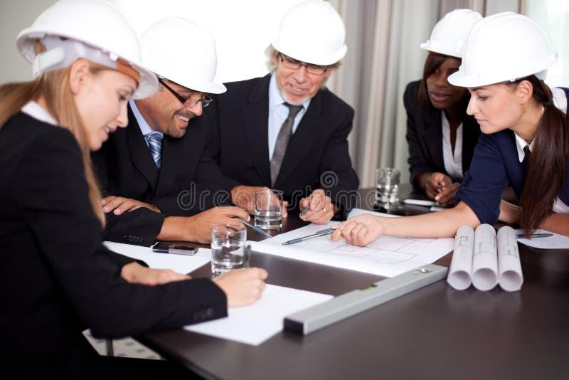 Happy successful engineers brainstorming royalty free stock photos