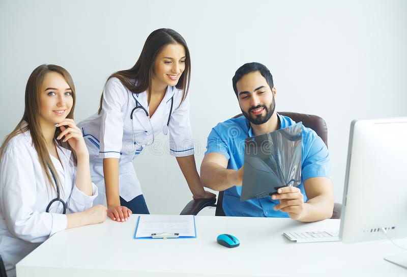 Happy Successful Medical Team work together in hospital.  royalty free stock photo