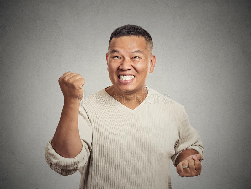 Happy successful student, man winning fists pumped celebrating success stock photos