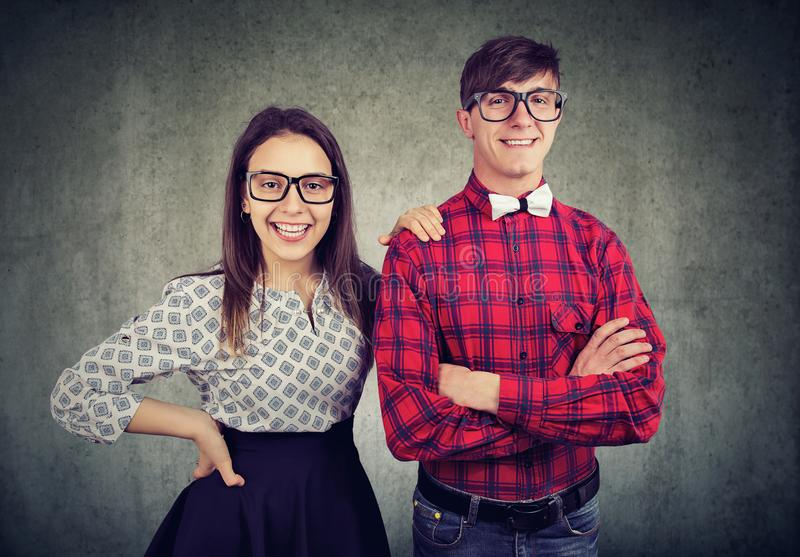 Happy successful young couple looking at camera stock photos