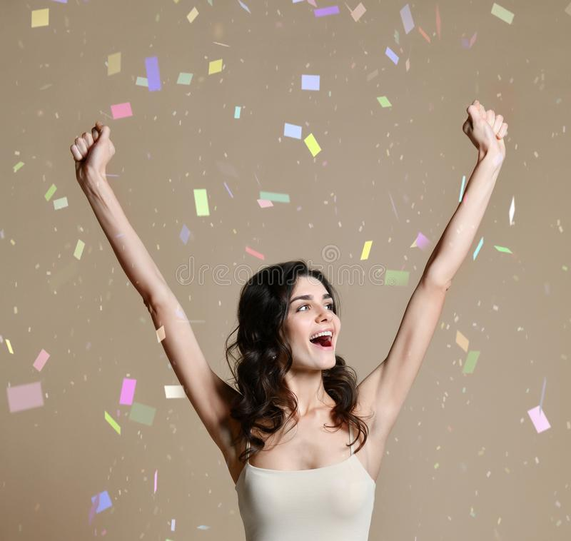 Happy successful young woman with raised hands shouting and celebrating success royalty free stock photos