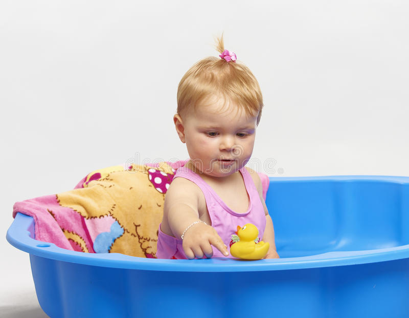 Happy summer baby playing stock image