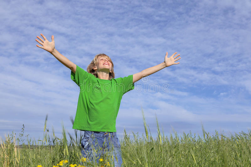 Happy summer child arms outstretched royalty free stock photography