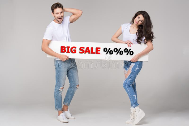 Happy summer couple with white board stock photo