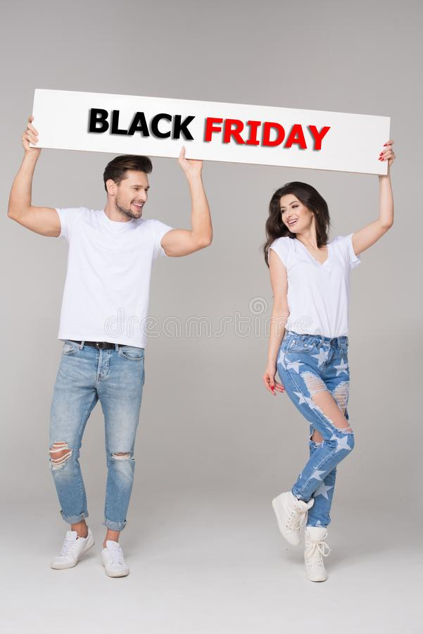 Happy summer couple with white board stock images