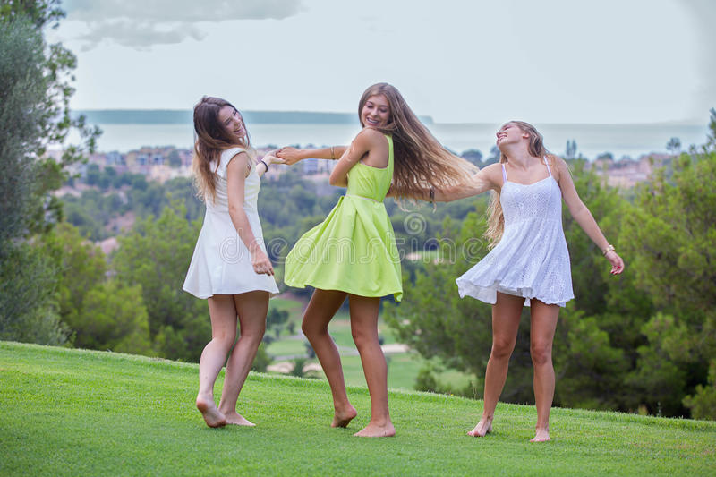 Happy summer teens. Dancing outdoors royalty free stock photography