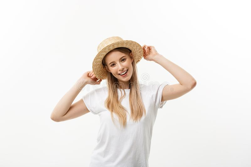 Happy summer woman isolated in white studio. Energetic fresh portrait of young woman excited cheering in wearing beach stock photography